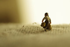 A miniature girl. Is migrating on a blanket Royalty Free Stock Photo