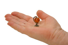 Miniature globe on the palm Royalty Free Stock Image