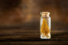Miniature Gold Christmas Trees in Glass Baubles Royalty Free Stock Photos