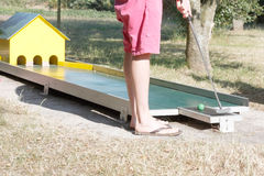 Miniature golf. A man playing miniature golf outside Stock Photos