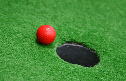 Miniature Golf. Heading for the hole Royalty Free Stock Images
