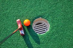 Miniature Golf. With orange ball and hole Royalty Free Stock Photography