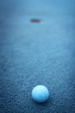 Miniature Golf. Setting up the next shot for miniature golf Royalty Free Stock Photography