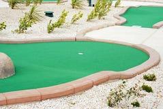 Miniature golf. Closeup miniature golf course with pebbles Stock Image