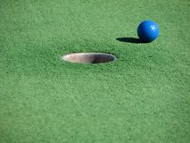 Miniature golf. Ball and putting surface Royalty Free Stock Image