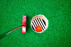Miniature Golf. Ball in the hole Stock Images