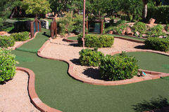 Miniature Golf. Popular miniature golf game at desert resort Royalty Free Stock Images