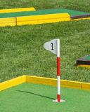 Miniature golf. Number one flag on a mini golf course Stock Photography