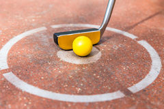 Miniature golf with ball at round Royalty Free Stock Image