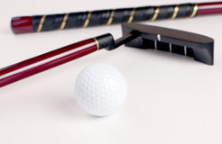 Miniature golf ball and stick isolated Stock Photography