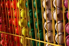 Miniature golf balls in a rack. Colorful choices for the round Stock Photos