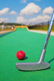 Miniature golf. Close-up of miniature golf bat and ball at the start of the track Royalty Free Stock Photo