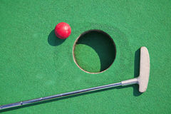 Miniature golf. Close-up of miniature golf hole with bat and ball Stock Images