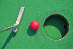 Miniature golf. Close-up of miniature golf hole with bat and ball Royalty Free Stock Images
