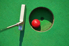 Miniature golf. Close-up of miniature golf hole with bat and ball Stock Photography