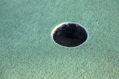 Miniature Golf Course Cup. Close up Stock Images