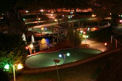 Miniature golf course at night. Lit up and beautiful at night Stock Photo