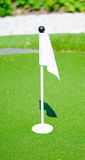 Miniature golf flag. A miniature golf flag on the mini golf adventure course Royalty Free Stock Photography