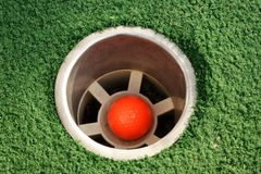 Miniature golf hole. A hole at a miniature golf course Stock Photo