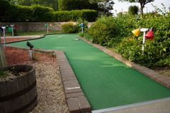 Miniature golf hole. A hole at a miniature golf course Royalty Free Stock Images