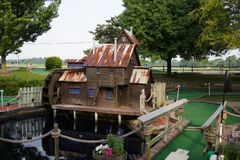 Miniature golf hole. A hole at a miniature golf course Royalty Free Stock Photo