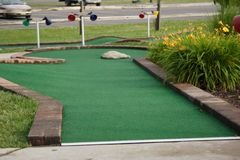 Miniature golf hole. A hole at a miniature golf course Stock Photos