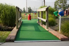 Miniature golf hole. A hole at a miniature golf course Stock Images