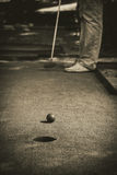 Miniature golf hole with bat and ball black  white Stock Photography