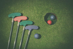 Miniature golf hole with bat and ball Royalty Free Stock Photography