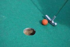 Miniature golf orange ball. Playing miniature golf orange ball Royalty Free Stock Photo