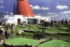 Miniature golf at sea. Passengers enjoy playing miniature golf on the deck of the Carnival Dream cruise ship Royalty Free Stock Image
