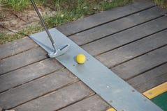 Miniature golf yellow ball. Playing miniature golf yellow ball Stock Image