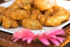 Miniature gourmet crab cakes Stock Photography