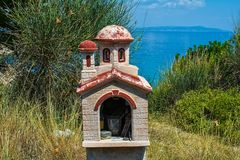 Miniature greek orthodox chapel by the sea royalty free stock photography