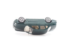 Miniature green  toy car in accident Stock Photography