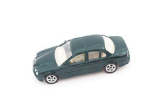 Miniature green toy car Royalty Free Stock Image