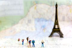 Miniature Group hiker and traveler backpack standing on wold map for travel Eiffel Tower in France and around the world,. Select focus Travel Concept stock images