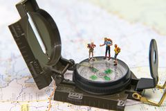Miniature Group traveler with backpack standing on wold map for travel around the world. Stock Photography