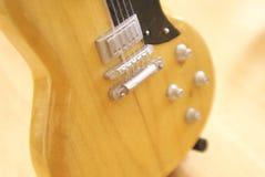 Miniature guitar Royalty Free Stock Image