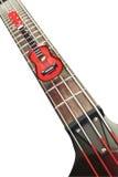Miniature guitar on bass guitar strings Stock Photos