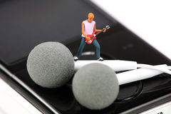 Miniature guitar player on an MP3 player Stock Image