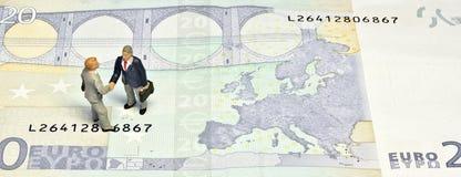 Miniature handshake twenty euros Stock Image
