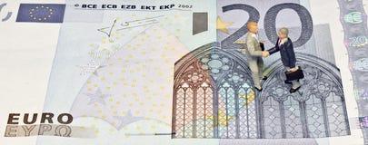 Miniature handshake twenty euros Royalty Free Stock Photos