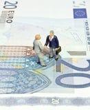 Miniature handshake twenty euros Stock Photography