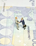 Miniature handshake twenty euros Royalty Free Stock Photos
