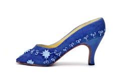A miniature high-heeled shoe Stock Photo