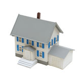 Miniature House. A miniature house isolated on a white background royalty free stock photography