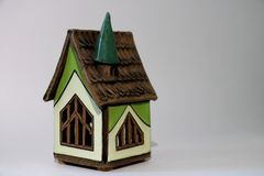 Miniature house with a brown roof. royalty free stock photo
