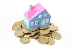 Miniature House with Coins Stock Images