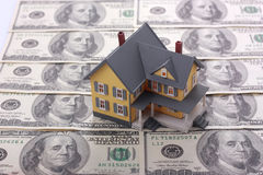 Miniature house on dollar banknotes Royalty Free Stock Photos